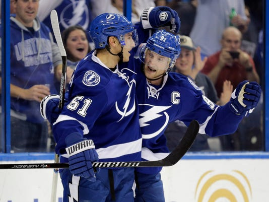 Tampa Bay Lightning center Valtteri Filppula (51), of Finland, celebrates with center Steven Stamkos (91) after scoring against the Vancouver Canucks during the second period of an NHL hockey game Tuesday, Jan. 20, 2015, in Tampa, Fla. (AP Photo/Chris O'Meara)