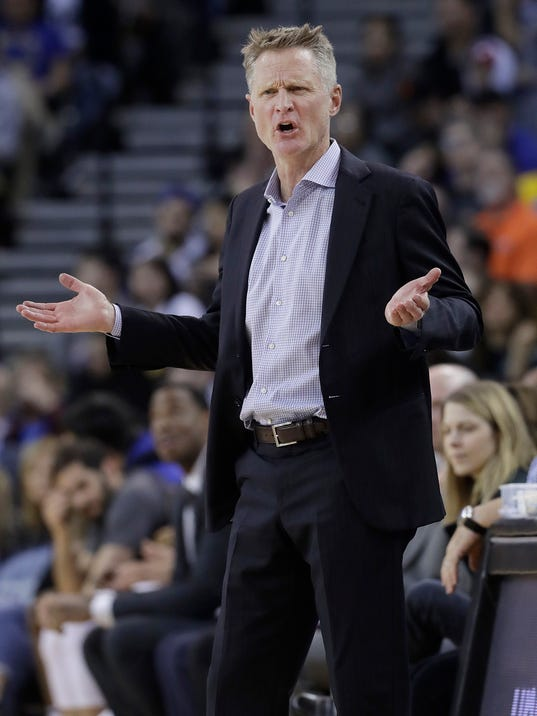Golden State Warriors coach Steve Kerr gestures during the second half of the team's NBA basketball game against the Brooklyn Nets in Oakland, Calif., Tuesday, March 6, 2018. (AP Photo/Jeff Chiu)