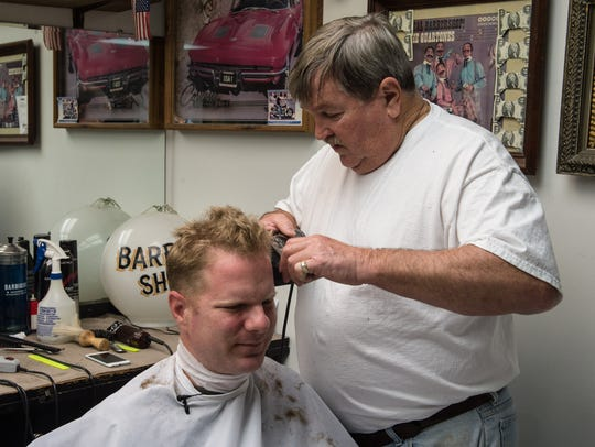 """Horace """"Pete"""" Tippett, owner of Dustin and Pete's Barbershop,"""