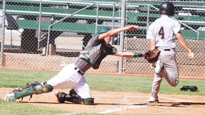 La Junta's Ian Backes (4) eludes the St. Mary's catcher to score in the first game of a doubleheader Monday at Potter Park. The Tigers won the first game 9-8, but lost the second 13-7.
