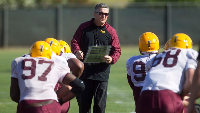 ASU Head Coach Todd Graham during Spring practice at the Kajikawa practice fields at ASU  in Tempe on Thursday, April 3, 2014.