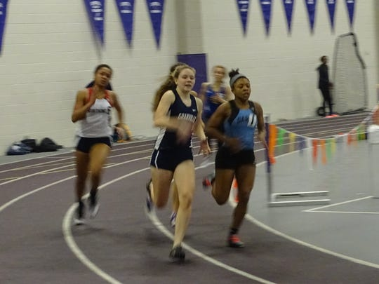 Granville junior Gracie Dennison leads her heat of the 400 on Sunday during the Division I Central District Indoor meet at Capital University.