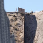 A Border Patrol agent watches over the border in Sunland Park.