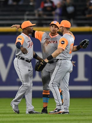 (From left) Tigers Justin Upton, Mikie Mahtook and Andrew Romine celebrate after the Tigers' 6-3 win over the White Sox on Saturday, Aug. 26, 2017, in Chicago.