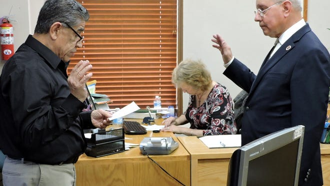 In photo at left, Esequiel Salas, on right, was sworn in as mayor of the Village of Columbus by Luna County Magistrate Court Judge, the Honorable Ray Baese. In photo at right, Village Trustees Bill Johnson, to the left of Judge Baese, and Richard Gutierrez, far right, were sworn in. The oath of office was given on Friday, March 9 at the Luna County Magistrate Courtroom.