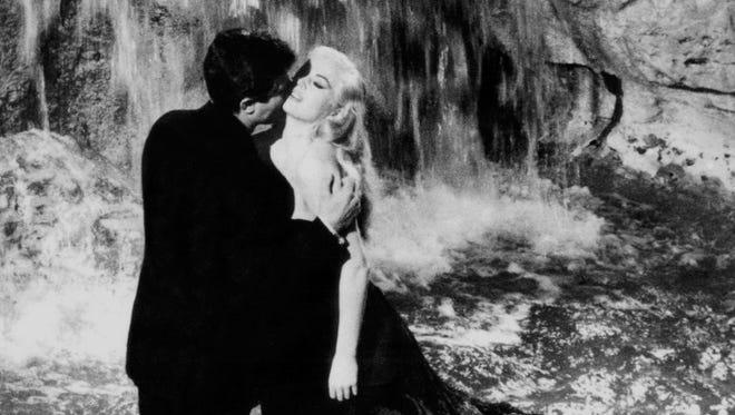 Italian actor Marcello Mastroianni (L) and Swedish actress Anita Ekberg in Rome's famous Trevi Fountain during the shooting of Federico Fellini's film 'La Dolce Vita'.