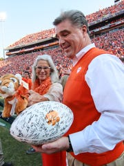 Dan and Marcie Radakovich join activities during senior day before kickoff on Saturday, November 12 at Memorial Stadium in Clemson.