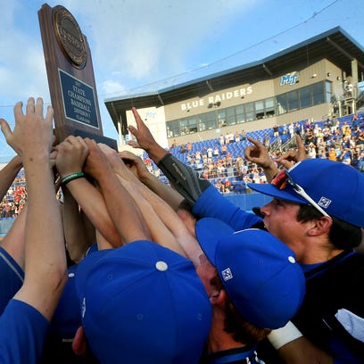 Brentwood players hold up the State Championship trophy