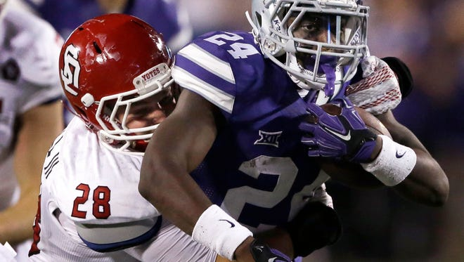 Kansas State running back Charles Jones (24) is tackled by South Dakota linebacker John Wessel (28) during the second half of last season's loss at Kansas State. Wessel will be counted on to lead an inexperienced defense in 2016.