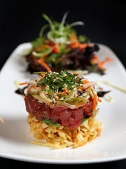 The Ahi Tuna Stack, prepared with layers of crispy