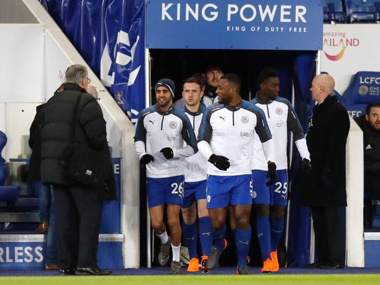 Leicester City's Riyad Mahrez, left, warms up with teammates prior to the Emirates FA Cup, Fifth Round soccer match at the King Power Stadium in Leicester, England, Friday Feb. 16, 2018.  Mahrez returned to Leicester's starting lineup Friday and helped the team reach the FA Cup quarterfinals, starting for the first time since the collapse of his move to Manchester City last month. (Martin Rickett/PA via AP)