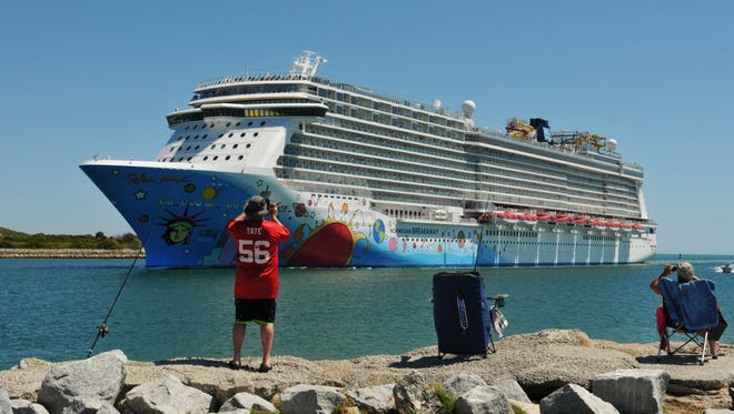 Spectators watch the Norwegian Breakaway sail into Port Canaveral for a port-of-call visit.
