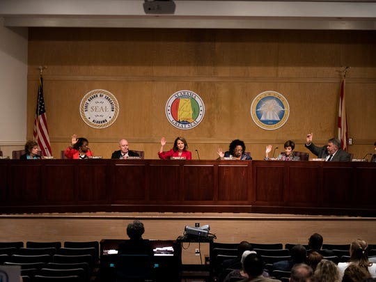 Jackie Zeigler, Betty Peters, Yvette Richardson, Michael Sentance, Stephanie Bell, Ella Bell, Cynthia McCarty, Jeff Newman, Mary Scott Hunter take a vote to accept an employee evaluation of Alabama Board of Education Superintendent Michael Sentance on Tuesday, July 25, 2017, in Montgomery, Ala.