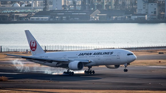 A Japan Airlines (JAL) Boeing 777 is seen landing at