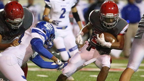 Jefferson's Jose Rubio, 21, carries the ball against