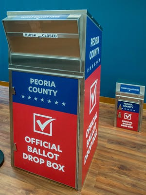 Ballot boxes sit in the office at the Peoria County Election Commission in Peoria. The large one will be bolted outside for drive-up ballot dropoffs on Election Day, while the small one will be available for early voting.