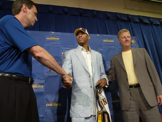 FILE -- Pacers first round draft pick Danny Granger, middle, is welcomed by head coach Rick Carlisle, left, and Pacers President Larry Bird.