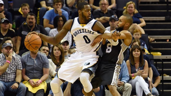 JaMychal Green #0 of the Memphis Grizzlies is defended by Patty Mills #8 of the San Antonio Spurs during the second half of game three of the Western Conference Quarterfinals during the 2016 NBA Playoffs between the San Antonio Spurs and the Memphis Grizzlies at FedExForum on April 22, 2016 in Memphis, Tennessee.