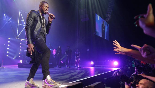 Usher performed at the Marcus Amphitheater at Summerfest 2014. It was the last day of Summerfest 2014.