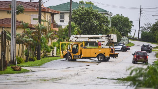 A Guam Power Authority crew responds to a call of downed power lines on Ypao Road after the passage of Tropical Storm Maria on Thursday, July 5, 2018.