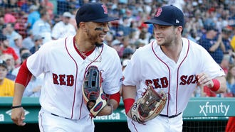 The Boston Red Sox are a startling 68-30 at the All-Star break and Mookie Betts, left, leads the AL in batting average at .359.