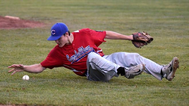 Campbelltown pitcher Sam Zeigler bobbles the ball while trying to field a bunt in Campbelltown's 9-2 loss to Pleasureville in the Region 4 tournament on Tuesday night.