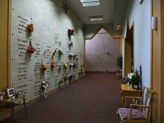 The wall at the New Calvary Catholic Cemetery mausoleum