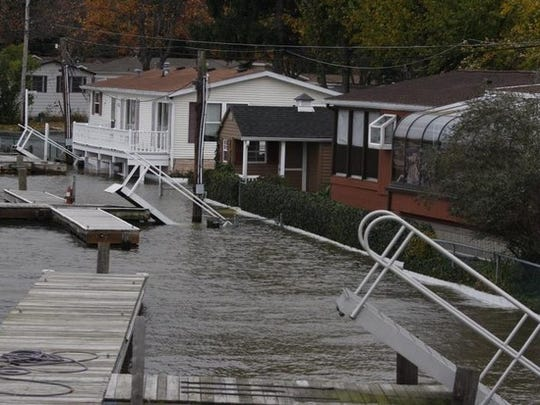 Docks rise in the water road on Ba Mar Drive in Stony Point on Oct. 29, 2012.