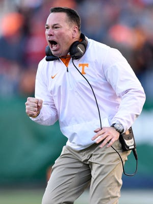 Tennessee Volunteers head coach Butch Jones reacts to the team's first touchdown in the first half of the Franklin American Mortgage Music City Bowl at Nissan Stadium in Nashville, Tenn., Friday, Dec. 30, 2016.
