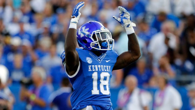 Sep 5, 2015; Lexington, KY, USA; Kentucky Wildcats running back Stanley Boom Williams (18) during the game against the Louisiana Lafayette Ragin Cajuns at Commonwealth Stadium. Kentucky defeated Louisiana Lafayette 40-33.