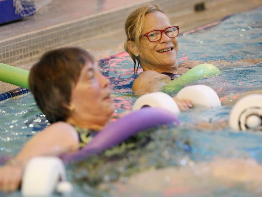 Instructor Lisa Burgess, top, leads participants in the aquacise class Thursday, July 6, 2017, at the YWCA. The high intensity workout in the water lasts for one hour.