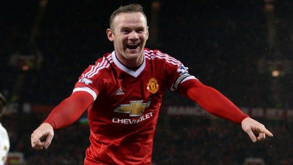 Manchester United's English striker Wayne Rooney celebrates