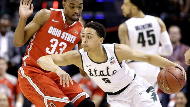 Ohio State Buckeyes forward Keita Bates-Diop (33) defends against Michigan State Spartans guard Bryn Forbes (5) at Bankers Life Fieldhouse in Indianapolis on March 11, 2016.