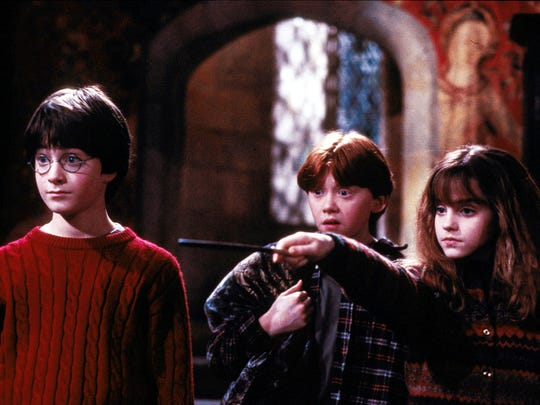 "Left to right, Harry Potter (Daniel Radcliffe), Ron Weasley (Rupert Grint) and Hermione Granger (Emma Watson) in ""Harry Potter and the Sorcerer's Stone."""