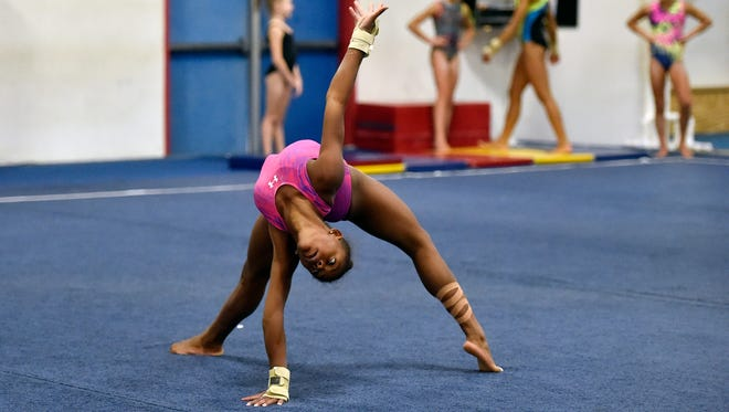Trinity Thomas practices her floor routine Thursday, Aug. 31, 2017, at Prestige Gymnastics in Lancaster County. Sisters Trinity Thomas, 16, and Tesia Thomas, 14, are different athletes in their own right, but each excels in her chosen discipline. Trinity Thomas is a gymnast on the U.S. senior national team who will attend Team USA's selection camp this month for a shot at a place on the squad for the world championships. Tesia Thomas is a standout three-season athlete for West York, where she plays volleyball, swims and is on the track and field team.