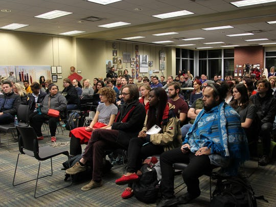 More than 100 Purdue faculty, staff and students gathered to discuss white supremacist posters that were plastered across the campus. The Purdue Social Justice Coalition held the meeting at the West Lafayette Public Library on Wednesday, Nov. 30, 2016.