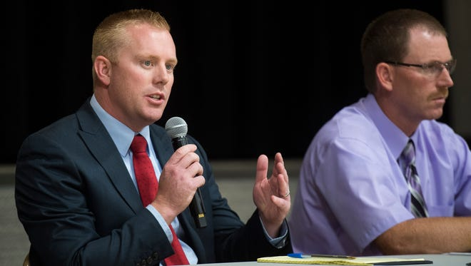 Candidate for Iron County Attorney Chad Dotson answers questions during the candidate debate at North Elementary School Thursday, May 31, 2018.