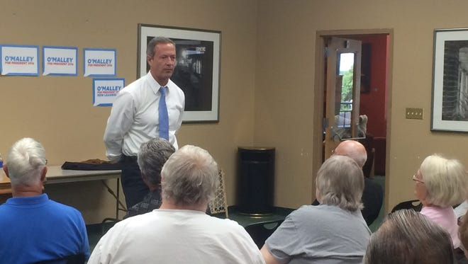 Democratic presidential candidate Martin O'Malley speaks to a group of 40 at a meet and greet in Muscatine on Sunday.