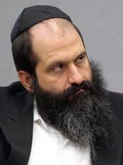 Former Agriprocessors executive Sholom Rubashkin listens