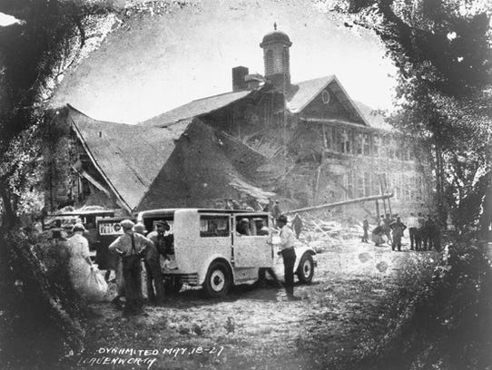 Loading an ambulance in the shadow of destruction,