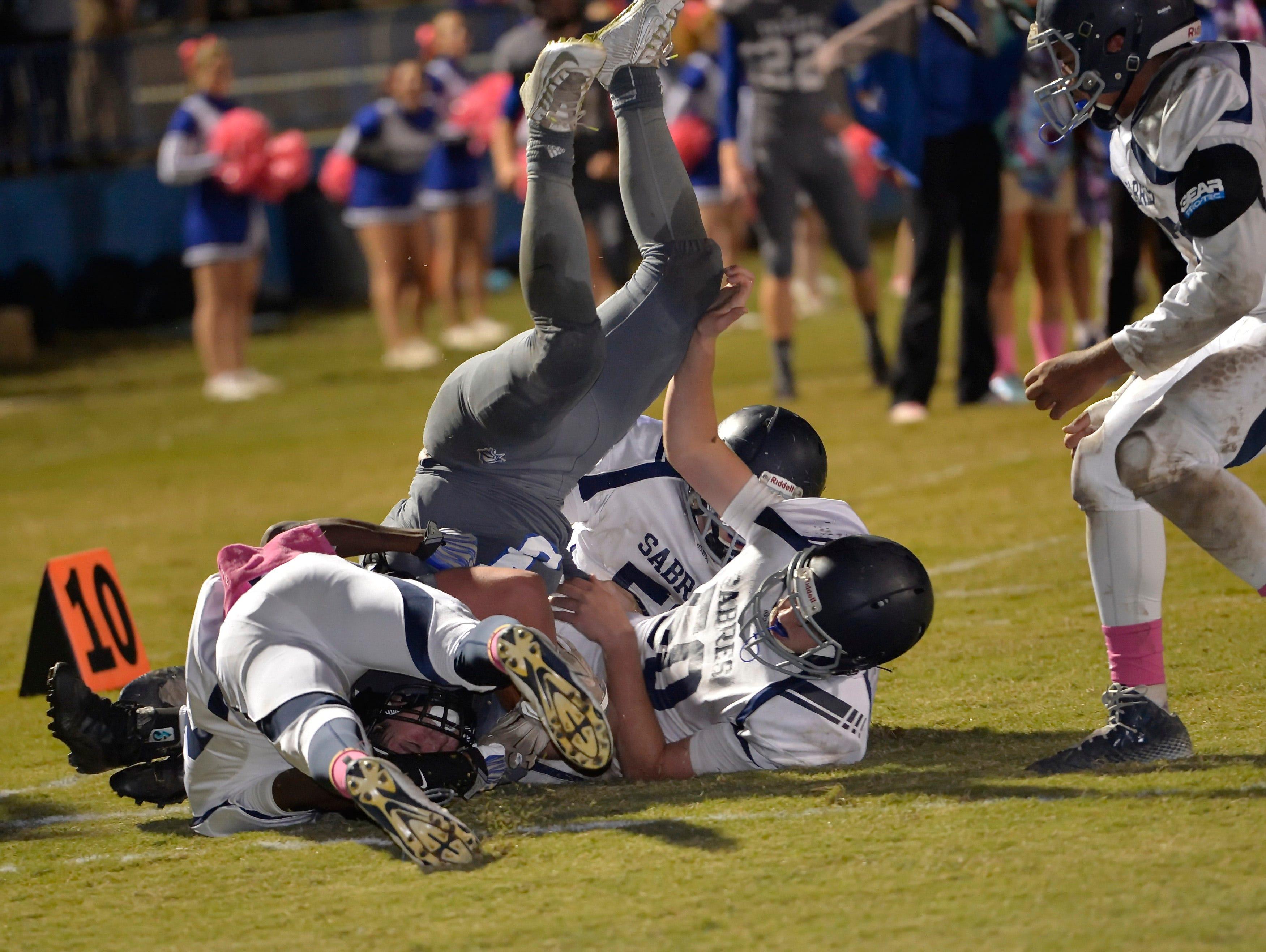 St. Joe's Luke Bikulege topples down inside the 10 yard line against Southside Christian Friday night.