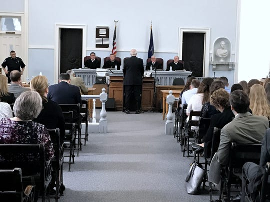 Spectators watch as justices of the state Supreme Court Appellate Division, Third Judicial Department, listen to a lawyer's argument during a special session Friday at the Chemung County Courthouse in Elmira.