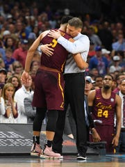 Loyola Ramblers coach Porter Moser and guard Marques