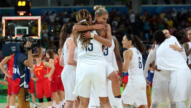 USA forward/guard Elena Delle Donne (11) and center Brittney Griner (15) celebrate after beating Spain in the women's basketball gold medal match during the Rio 2016 Summer Olympic Games at Carioca Arena 1 on Aug. 20.