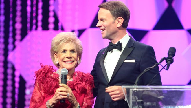 Annette Bloch and Desert AIDS Project CEO David Brinkman onstage Saturday night at the Steve Chase Humanitarian Awards, as Bloch announces her $3 million donation to D.A.P.
