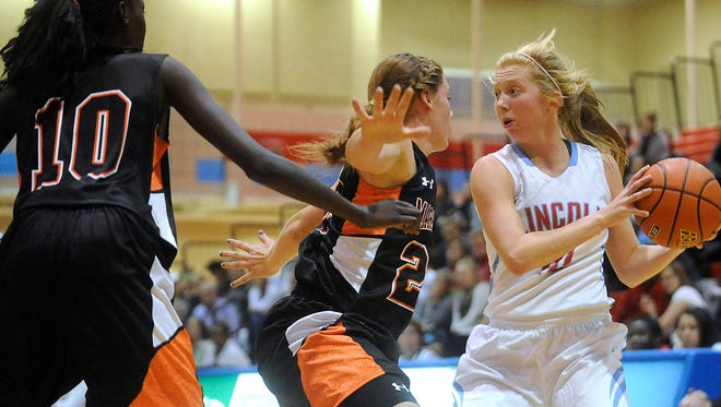 Lincoln's Anna Brecht (right), pictured against Marshall (Minn.) on Dec. 22, eclipsed the 30-point mark twice in the past week.