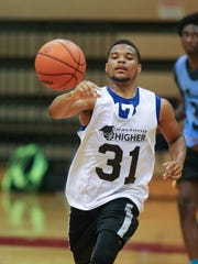 Malik Ellison from Flint Beecher high school competes