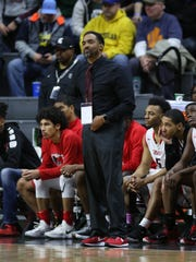 Detroit Edison PSA coach Brandon Boe Neely on the bench