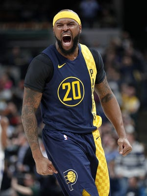 Indiana Pacers forward Trevor Booker (20) celebrates a Victor Oladipo dunk in the second half of their game at Bankers Life Fieldhouse on Thursday, April 5, 2018. The Indiana Pacers defeated the Golden State Warriors124-104.