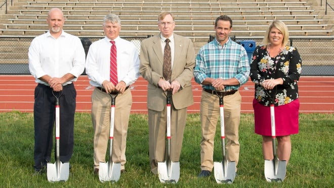 South Western High School recently broke ground for a new synthetic turf field. Patricipants in the groundbreaking ceremony were, from left, Nate Osborne (director of school facilities), John J. Luciani (president of First Capital Engineering), Ray Mummert (school board president), G. Paige Wingert (graduate, parent, school board member and capital campaign co-chair) and Toshia Brodbeck (graduate, teacher, coach and capital campaign co-chair).